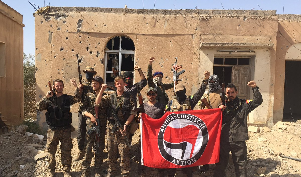 Caleb Stevens (fourth from left) in Raqqa with other politically motivated members of his unit. (Courtesy Caleb Stevens)