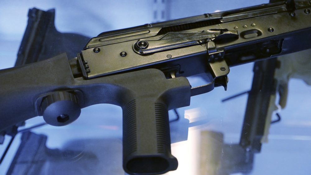 "In this Oct. 4, 2017, photo, a device called a ""bump stock"" is attached to a semi-automatic rifle at the Gun Vault store and shooting range in South Jordan, Utah.  (Rick Bowmer/AP)"