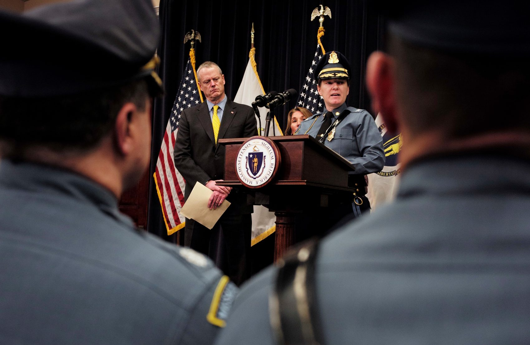 Gov. Charlie Baker and State Police Col. Kerry Gilpin face reporters during a news conference to announce reforms for the embattled agency. (Steven Senne/AP/file)