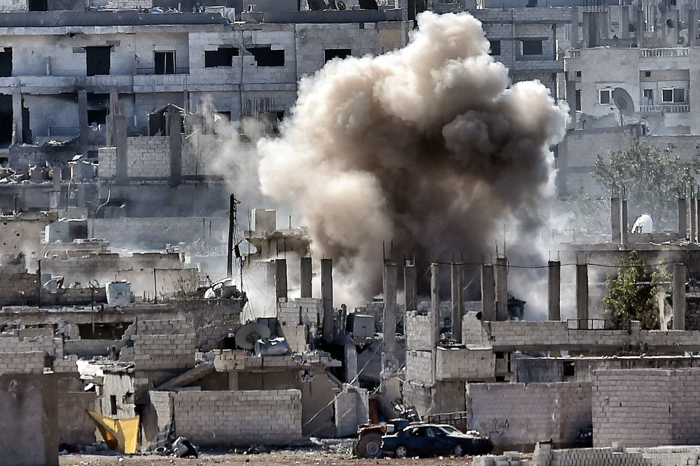 Smoke rises during a shelling by Islamic State militants to the Syrian city of Kobane, also known as Ain al-Arab on Nov. 6, 2014 from the Turkish city of Mursitpinar. (Aris Messinis/AFP/Getty Images)