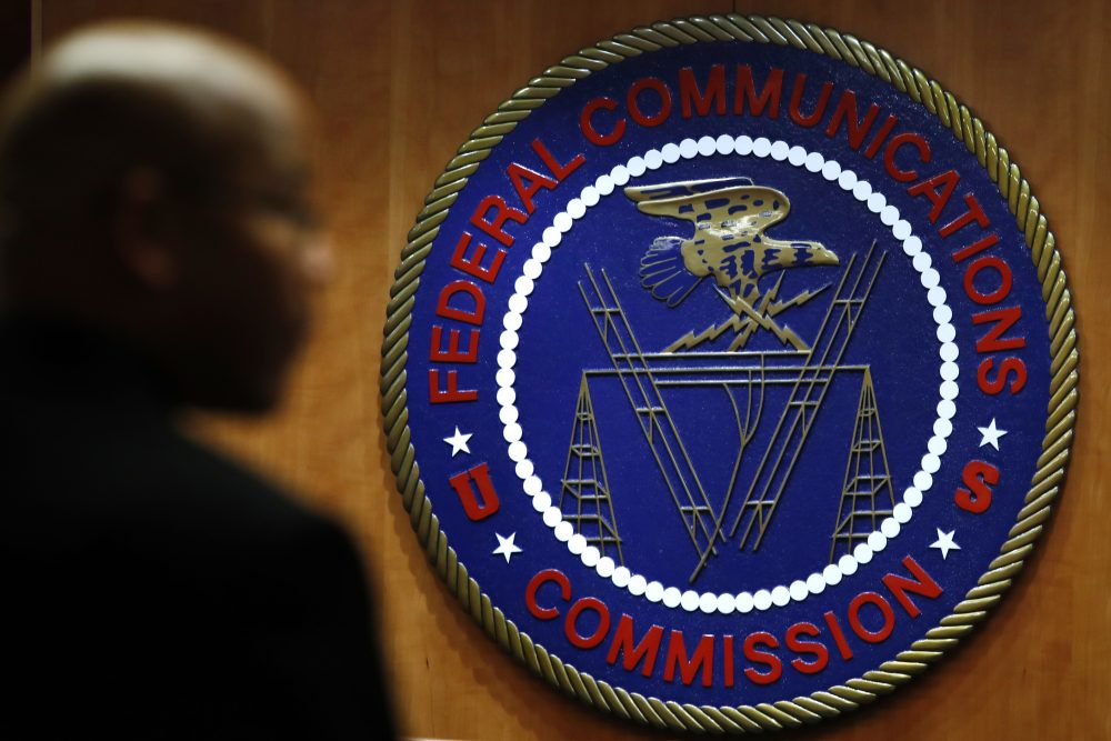 This Thursday, Dec. 14, 2017, photo, shows the seal of the Federal Communications Commission before a meeting in Washington. (AP Photo/Jacquelyn Martin)
