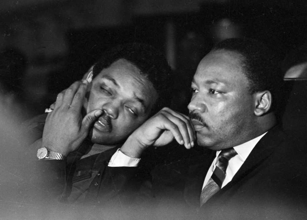 Dr. Martin Luther King, Jr. is seen here with the Rev. Jesse Jackson, left, just prior to his final public appearance to address striking Memphis sanitation workers on April 4, 1968.  King was assassinated later that day outside his motel room. (Charles Kelly/AP)