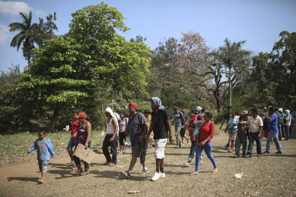 "Central American migrants arrive to a sports center during the annual Migrant Stations of the Cross caravan or ""Via crucis,"" organized by the ""Pueblo Sin Fronteras"" activist group, in Matias Romero, Oaxaca state, Mexico, Monday, April 2, 2018. A Mexican government official said the caravans are tolerated because migrants have a right under Mexican law to request asylum in Mexico or to request a humanitarian visa allowing travel to the U.S. border to seek asylum in the United States. (Felix Marquez/AP)"