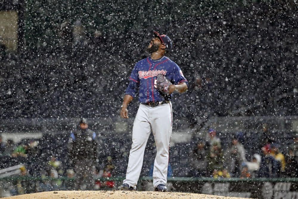 Baseball in the snow is becoming a more familiar sight. (Gene J. Puskar/AP)