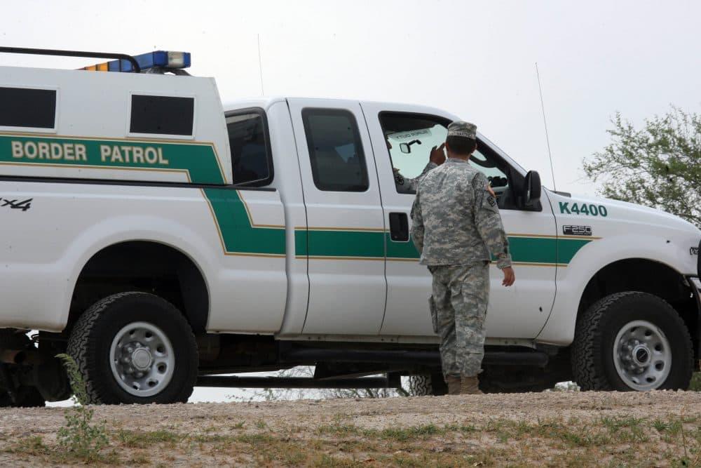 In this April 19, 2011 photo, a National Guardman talks with U.S. Border Patrol agents stationed along the Hidalgo International Bridge in Hidalgo, Texas. (Delcia Lopez/AP)