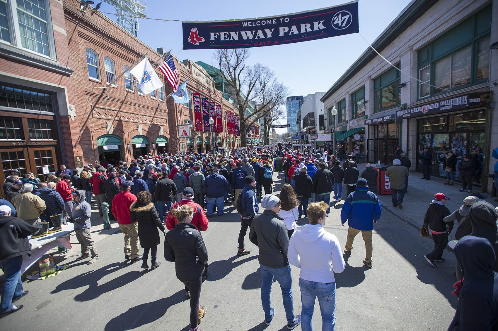 Red Sox fans line up outside the turnstiles on Yawkey Way on Opening Day at Fenway Park. (Jesse Costa/WBUR)