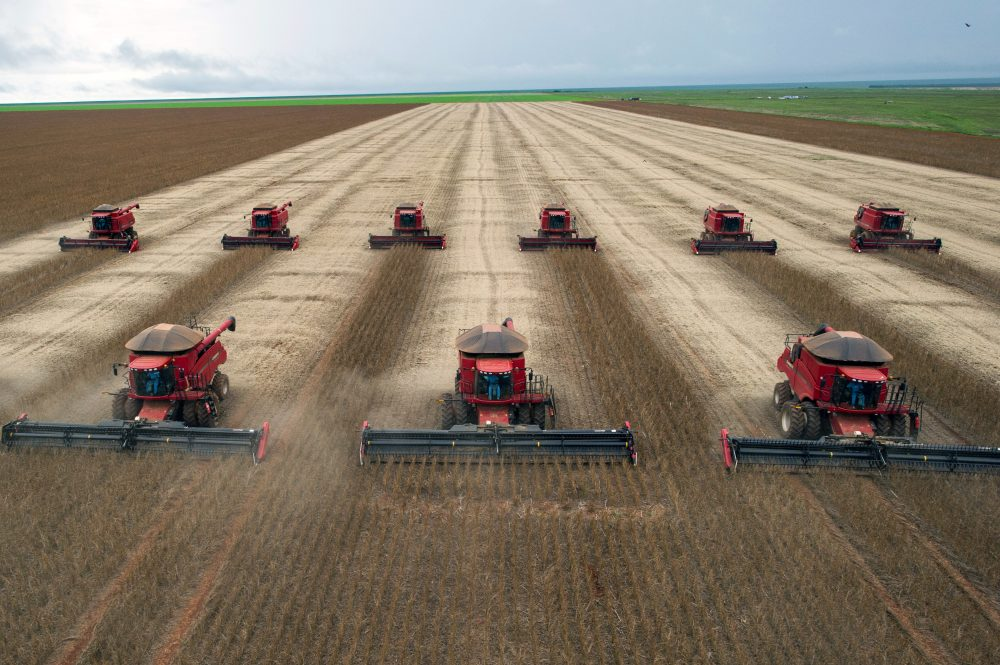 Combine harvesters crop soybeans during a demonstration for the press, in Campo Novo do Parecis, in Mato Grosso, Brazil, on March 27, 2012. (Yasuyoshi Chiba/AFP/Getty Images)