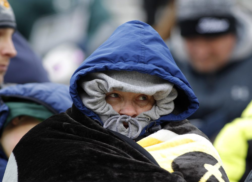A Michigan State fan bundles up in the cold before an NCAA college football scrimmage, Saturday, April 7, 2018, in East Lansing, Mich. (Al Goldis/AP)