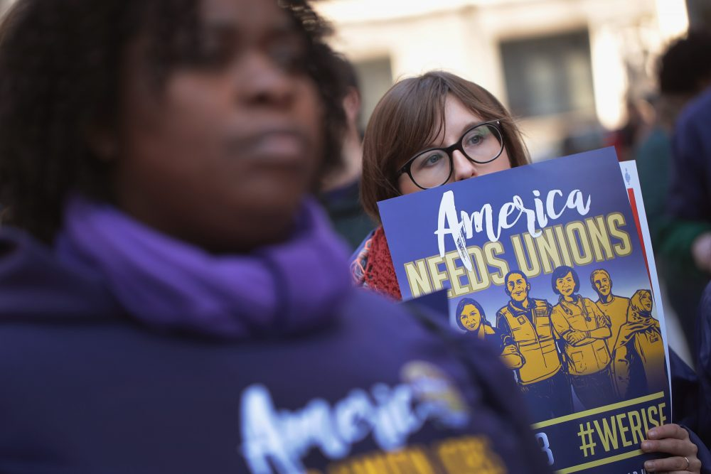 Members of the Service Employees International Union (SEIU) hold a rally in support of the American Federation of State County and Municipal Employees (AFSCME) union at the Richard J. Daley Center plaza on Feb. 26, 2018 in Chicago, amid the U.S. Supreme Court hearing arguments in Janus v. AFSCME, a lawsuit that challenges unions' authority under state law to collect compulsory fees from all employees they serve. (Scott Olson/Getty Images)