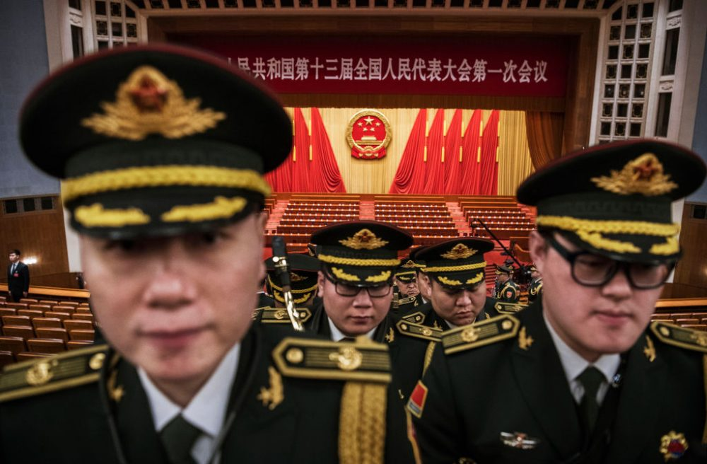 "Members of a band from the People's Liberation Army leave following a speech by China's President Xi Jinping after the closing session of the National People's Congress at The Great Hall Of The People on March 20, 2018 in Beijing, China. The annual gathering of Chinese lawmakers concluded with a nationalistic speech by president Xi Jinping, his first public address since the abolishment of term limits marked the beginning of his indefinite rule.  Xi spoke confidently of China's determination to take its place in the world, and gave the strongest sign in decades that the Communist government wants to bring Taiwan back under Beijing's control.  Xi warned that China would never allow ""one inch"" of territory to be separated from it, and said any attempts to split China will receive ""the punishment of history."" The denunciation appeared to be aimed at the United States, after U.S. President Donald Trump signed the Taiwan Travel Act this week that allows high-level U.S. visits to Taiwan. (Kevin Frayer/Getty Images)"