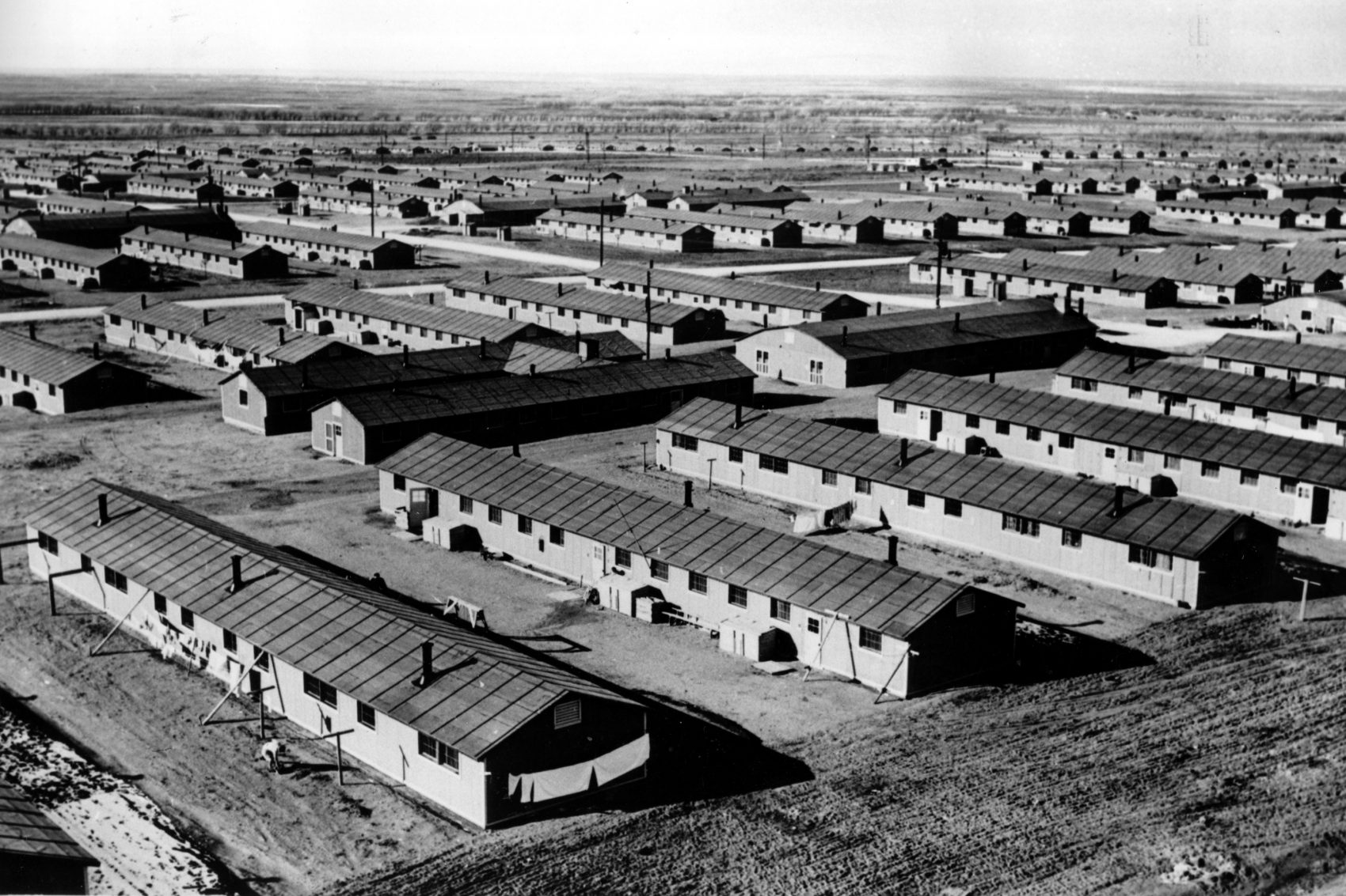 The housing barracks, built by the U.S. Army Engineer Corps, at the internment center where Japanese Americans were relocated in Amache, Colo., are shown on June 21, 1943. (AP Photo)