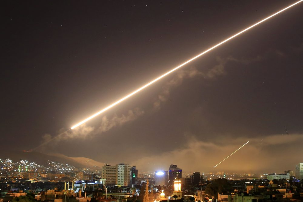 Damascus skies erupt with surface to air missile fire as the U.S. launches an attack on Syria early Saturday, April 14, 2018. (Hassan Ammar/AP)
