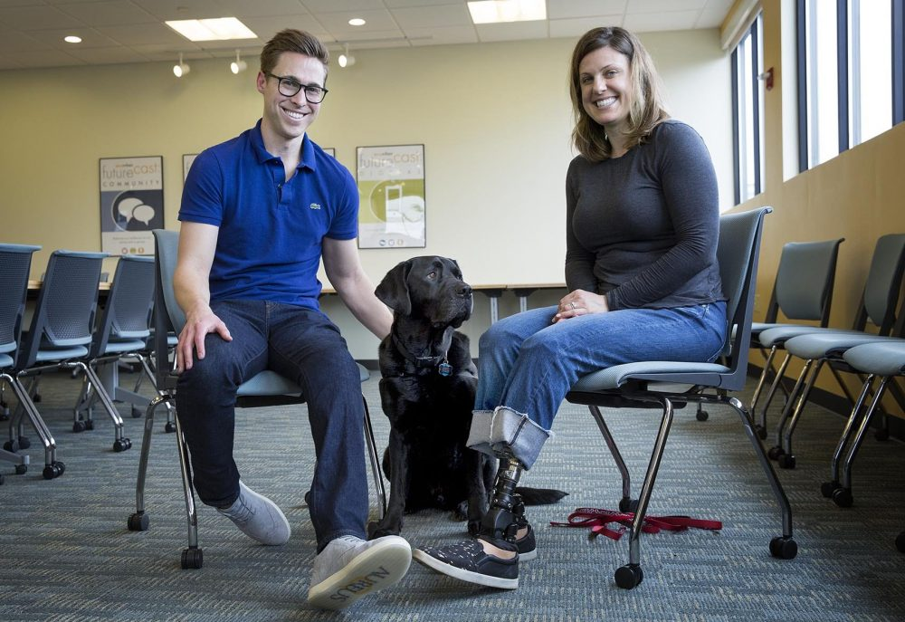 """Patrick Downes, Jessica Kensky and serevice dog Rescue. Kensky and Downes are co-authors of """"Rescue and Jessica: A Life-Changing Friendship."""" (Robin Lubbock/WBUR)"""