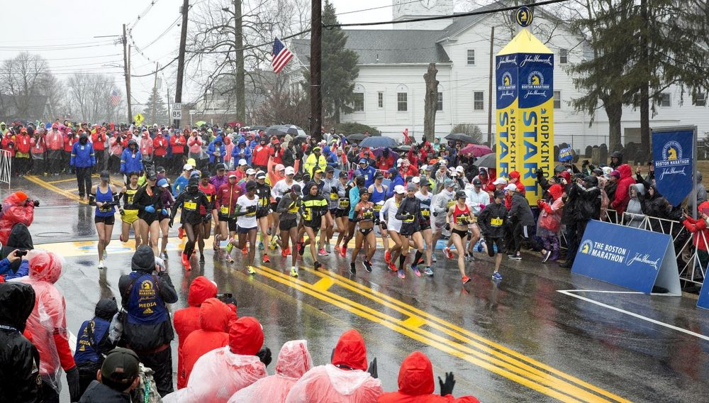 Boston Marathon elite women runners cross the starting line in Hopkinton. (Robin Lubbock/WBUR)