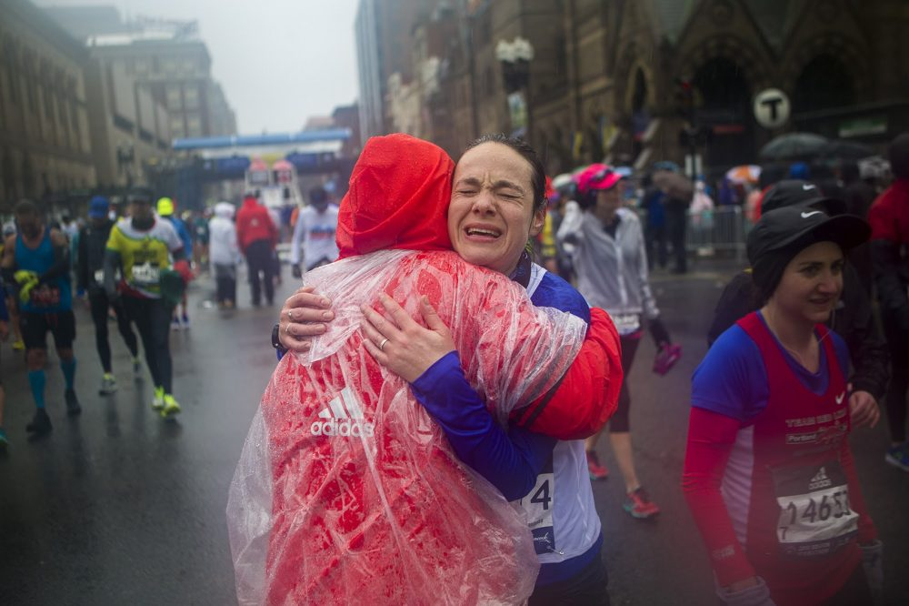 Alexandra Barak of Israel gets a congratulatory hug from Boston Marathon volunteer Angela Coulombe after finishing. (Jesse Costa/WBUR)