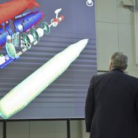 """Russian President Vladimir Putin, right, listens to President of National Research Center """"Kurchatov Institute"""" Mikhail Kovalchuk, as he visits Kurchatov Insitute of Atomic Energy, the home of the Soviet nuclear weapons program and later Soviet and Russian non-military nuclear technologies in Moscow, Russia, Tuesday, April 10, 2018. (Alexei Nikolsky, Sputnik, Kremlin Pool Photo via AP)"""