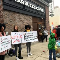 """Protesters gather outside a Starbucks in Philadelphia, Sunday, April 15, 2018, where two black men were arrested Thursday after Starbucks employees called police to say the men were trespassing. The arrest prompted accusations of racism on social media. Starbucks CEO Kevin Johnson posted a lengthy statement Saturday night, calling the situation """"disheartening"""" and that it led to a """"reprehensible"""" outcome. (AP Photo/Ron Todt)"""