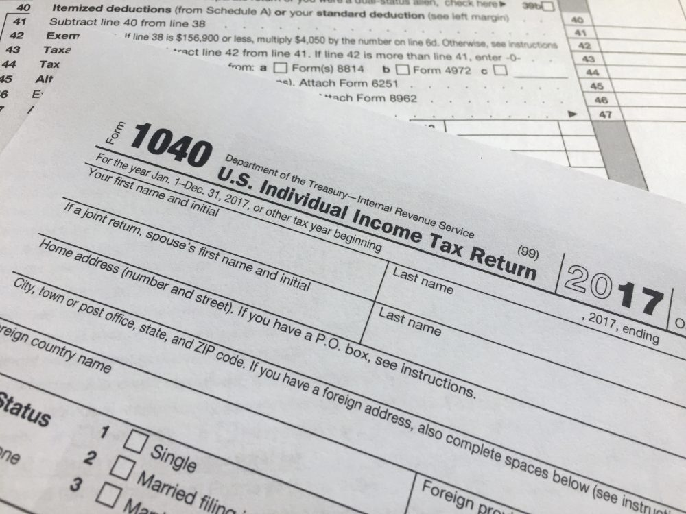 An IRS 1040 form, U.S. Individual Income Tax Return, is shown on Thursday, April 5, 2018, in New York. (AP Photo/Jenny Kane)