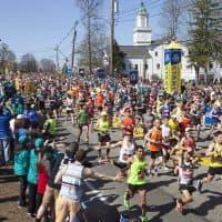 Wave one of the general runners at the start to the Boston Marathon in Hopkinton, Massachusetts. (Joe Difazio for WBUR)