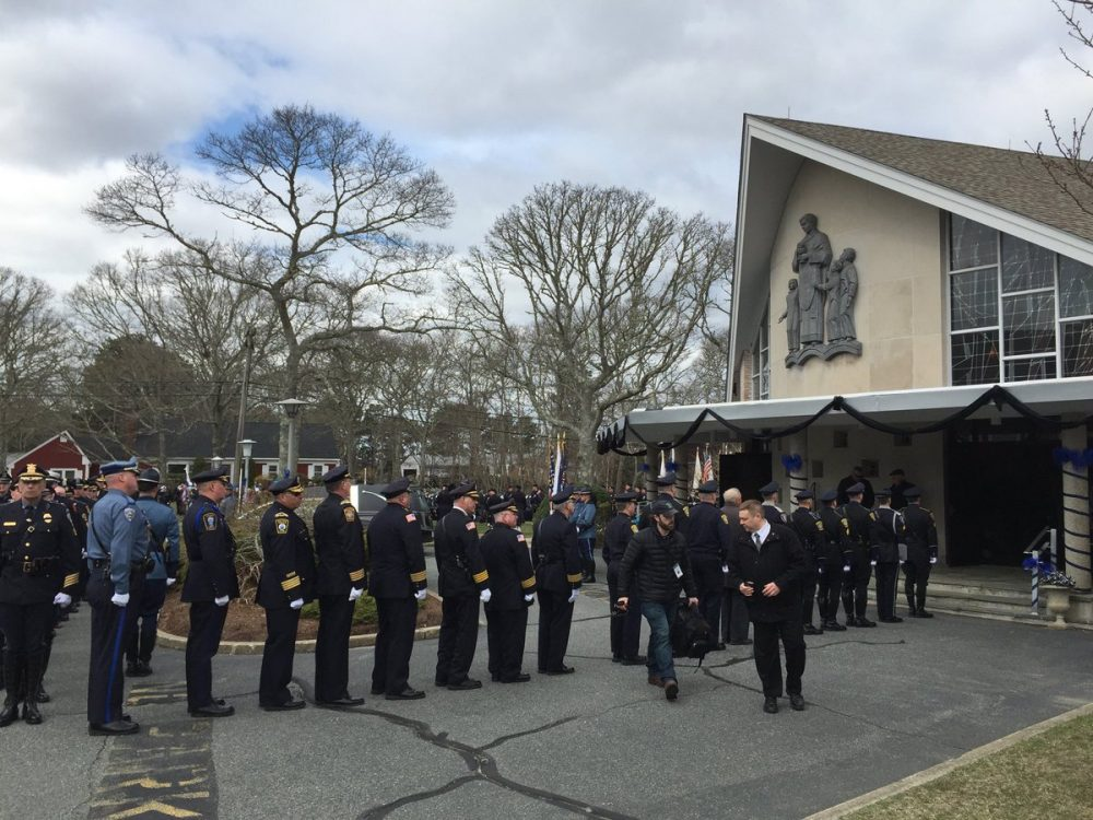 Thousands of officers and civilians on Wednesday morning file into St. Pius X Parish, a Roman Catholic Church in Yarmouth