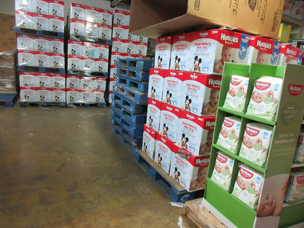 This Sept. 9, 2016 photo shows boxes of donated diapers stacked in a warehouse in North Haven, Conn. The National Diaper Bank Network, which operates the warehouse, distributes the diapers to agencies and community-based organizations like churches, which in turn provide them to families in need. (Beth J. Harpaz/AP)