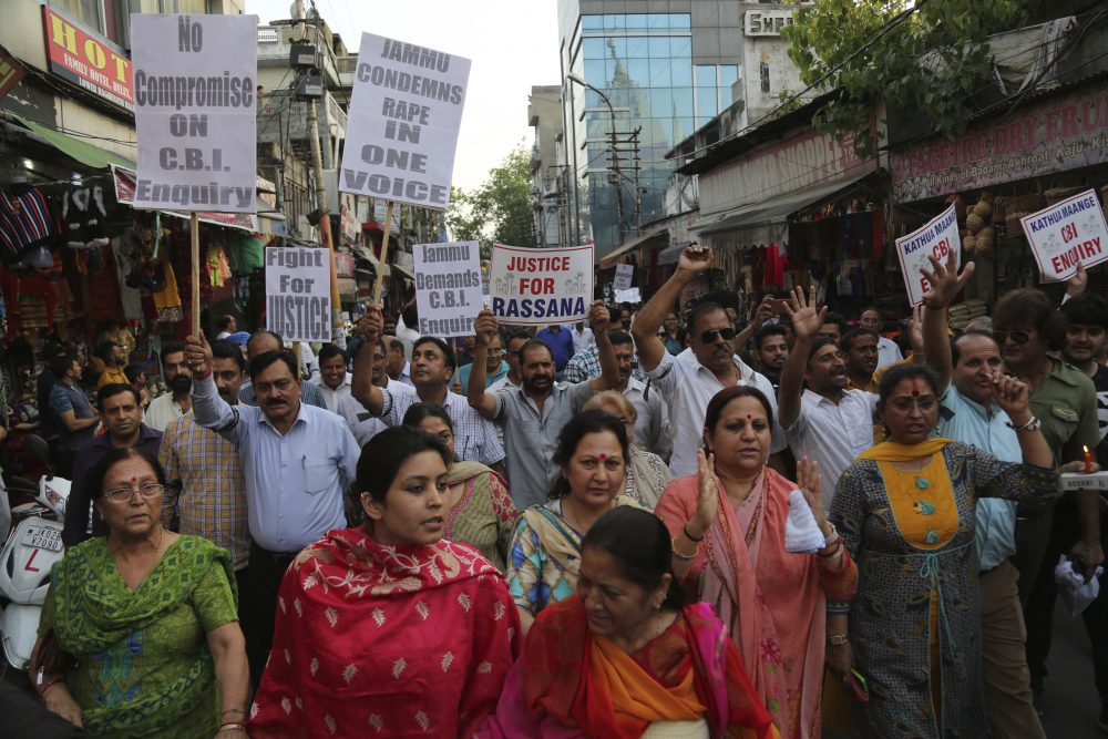 Indians carry placards and march in a rally demanding the investigation into the rape and murder of an 8-year-old girl be handed over to the Central Bureau of Investigation (CBI), in Jammu, India, Thursday, April 19, 2018. (Channi Anand/AP)