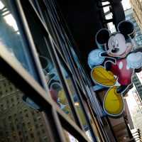 An image of Mickey Mouse, the official mascot of The Walt Disney Company, is displayed outside the Disney Store in Times Square, Dec. 14, 2017 in New York City. (Drew Angerer/Getty Images)