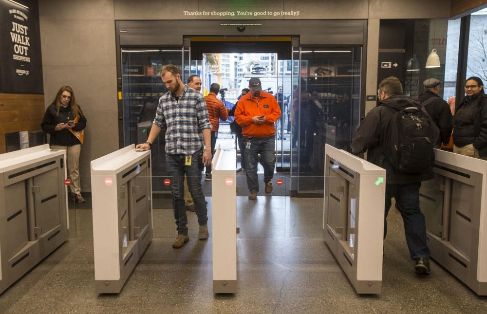 Shoppers enter and check out with purchases at the Amazon Go, on Jan. 22, 2018 in Seattle. After more than a year in beta, Amazon opened the cashierless store to the public. (Stephen Brashear/Getty Images)