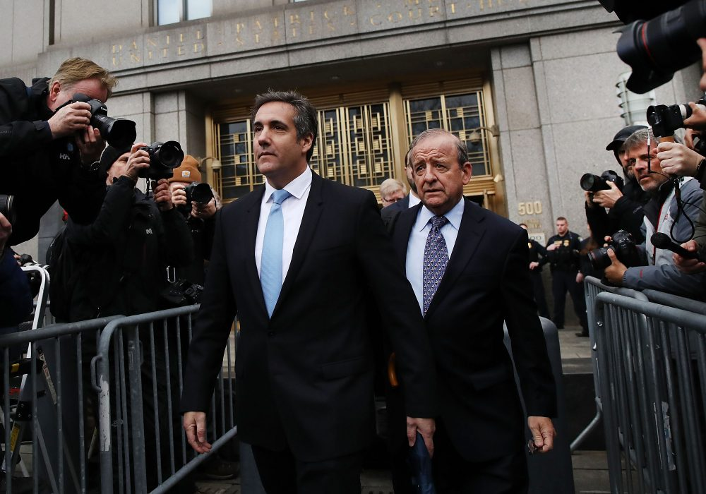President Trump's longtime personal attorney Michael Cohen (left) exits a New York court on April 16, 2018 in New York City. Trump's lawyers asked a federal judge to temporarily block prosecutors from reviewing files seized by the FBI from Cohen's offices and hotel room earlier this month. Trump's lawyers have argued that many of the documents are protected by attorney-client privilege. (Spencer Platt/Getty Images)