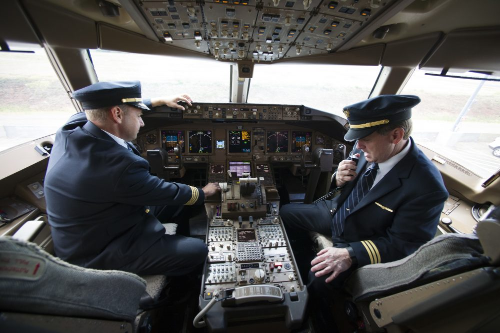 United Airlines Capt. Tommy Holloman, left, and Capt. Chuck Stewart in the cockpit of a United Airlines Boeing 777 at Dulles International Airport Air Traffic Control Tower in Sterling, Va., Tuesday, Sept. 27, 2016. (Cliff Owen/AP)