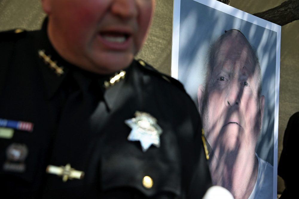 """A photo of accused rapist and killer Joseph James DeAngelo is displayed during a news conference on April 24, 2018 in Sacramento, Calif. Sacramento District Attorney Anne Marie Schubert was joined by law enforcement officials from across California to announce the arrest of the 72-year-old DeAngelo, who is believed to be the """"Golden State Killer"""" who killed at least 12, raped over 45 people and burglarized hundreds of homes throughout California in the 1970s and '80s. (Justin Sullivan/Getty Images)"""
