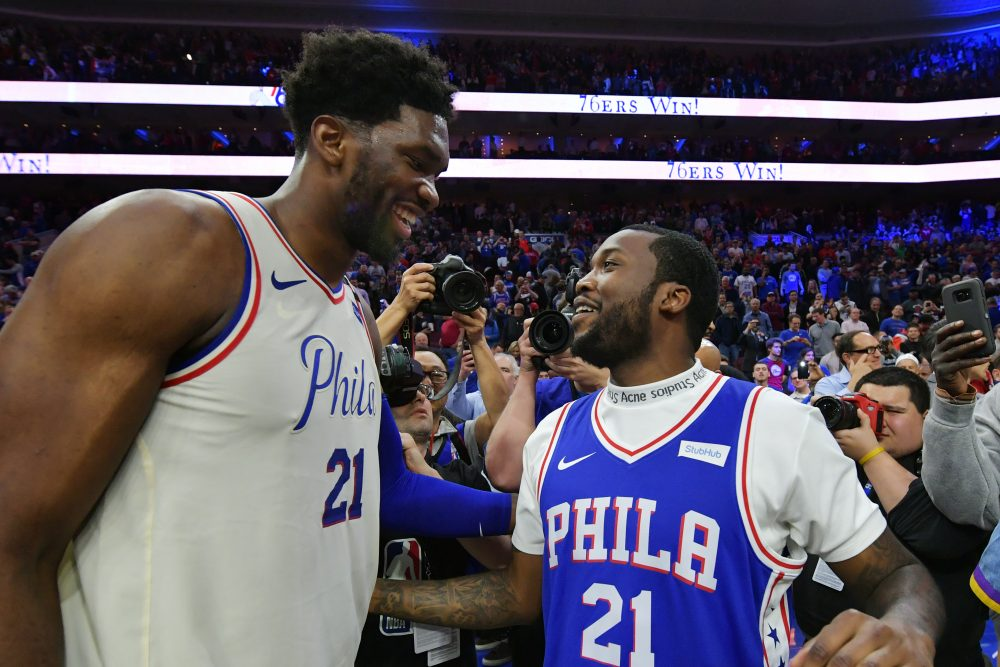 Joel Embiid celebrates with Meek Mill after the 76ers clinched their first round series against the Miami Heat. (Drew Hallowell/Getty Images)
