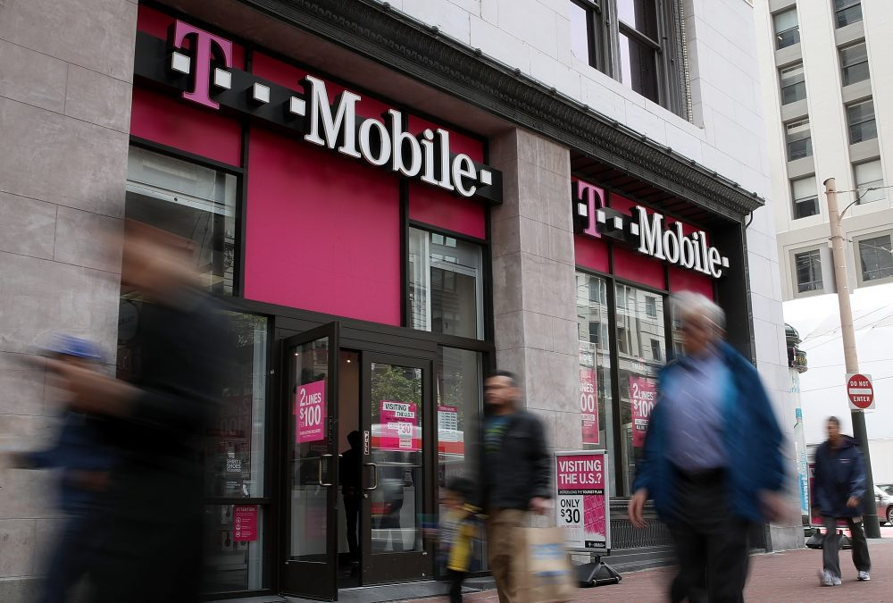 Pedestrians walk by a T-Mobile store on April 24, 2017 in San Francisco. (Justin Sullivan/Getty Images)