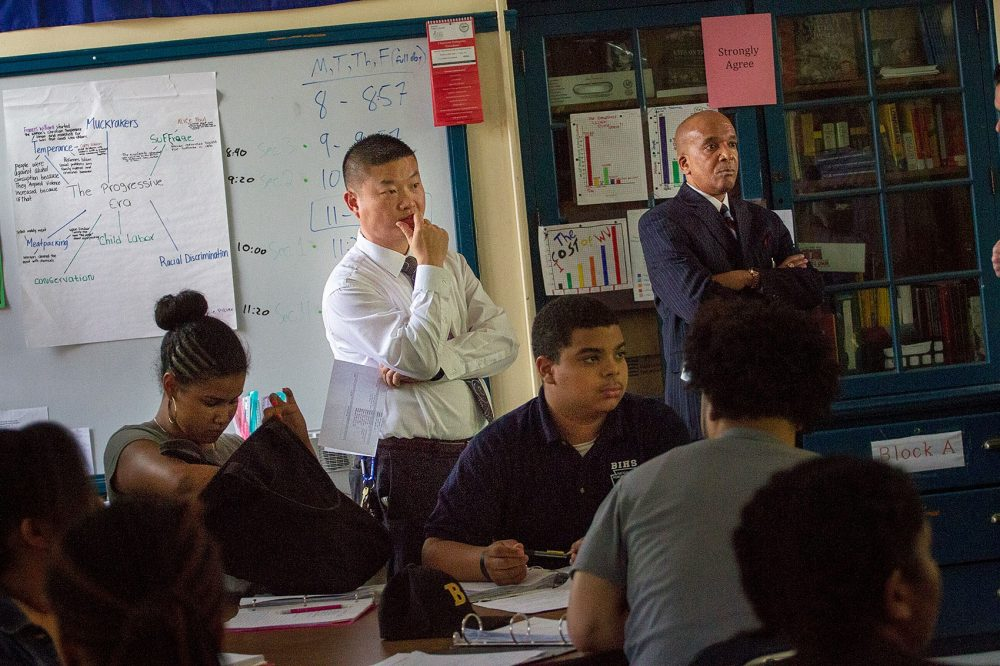 Boston Schools Superintendent Tommy Chang observes a class at the Boston International High School. (Jesse Costa/WBUR)