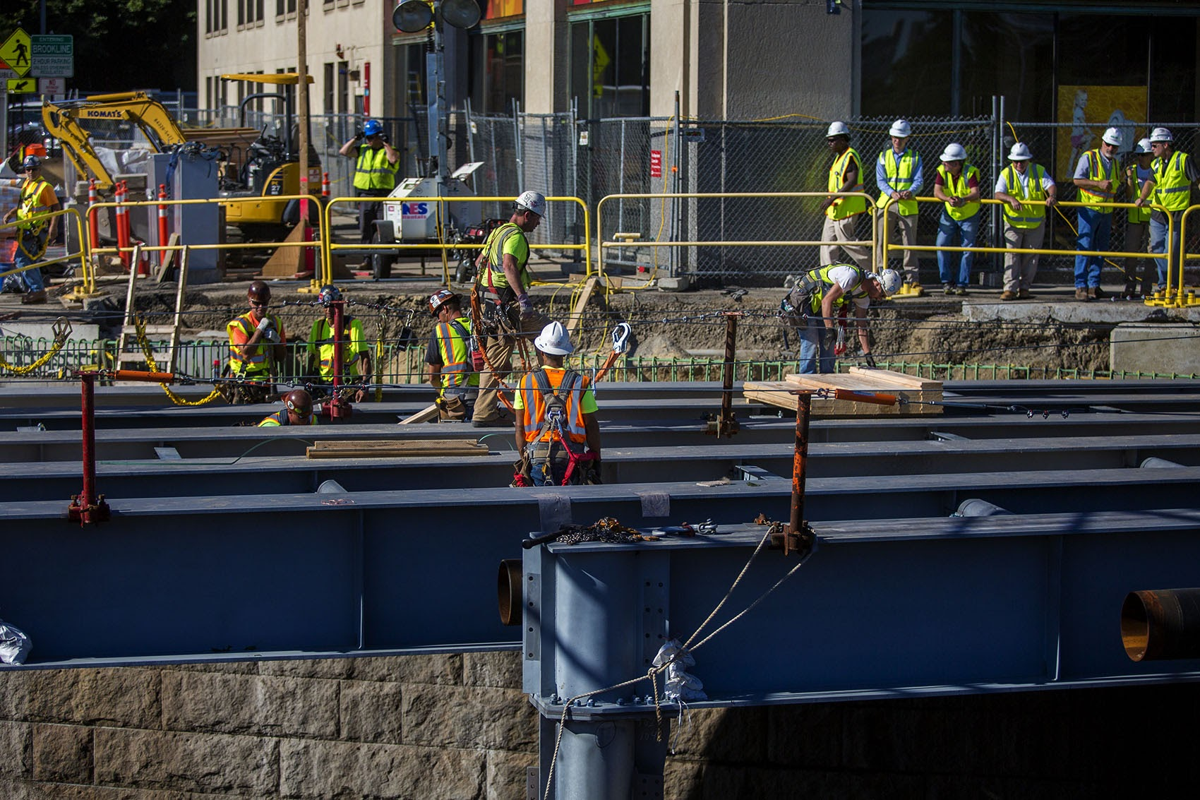 Contractors work on replacing the eastbound side of the Commonwealth Avenue Bridge on July 31, 2017. (Jesse Costa/WBUR)