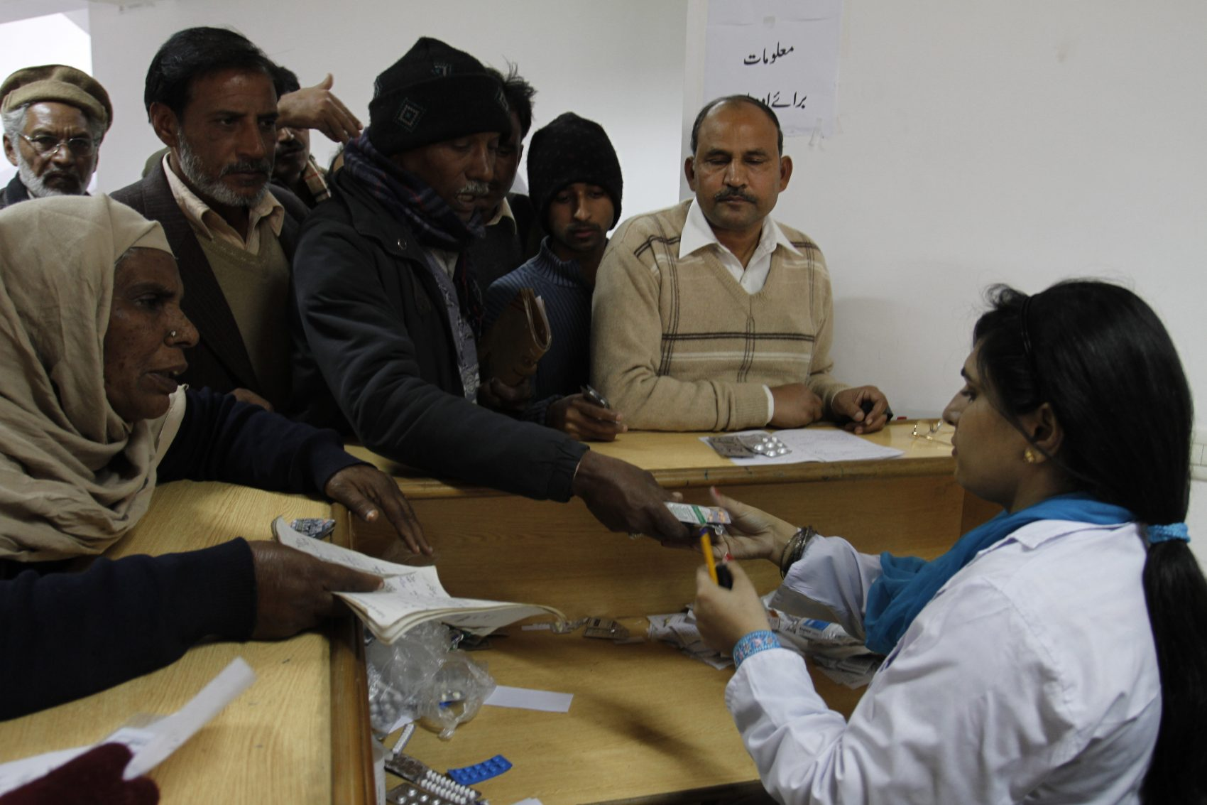 Pakistani family members of patients return medicines to a hospital in Lahore, Pakistan on Jan 23, 2012. Bad drugs were blamed for killing dozens. (K.M.Chaudary/AP)