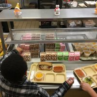 In this Jan. 25, 2017 photo, students fill their lunch trays at J.F.K Elementary School in Kingston, N.Y., where all meals are now free under the federal Community Eligibility Provision. (Mary Esch/AP)