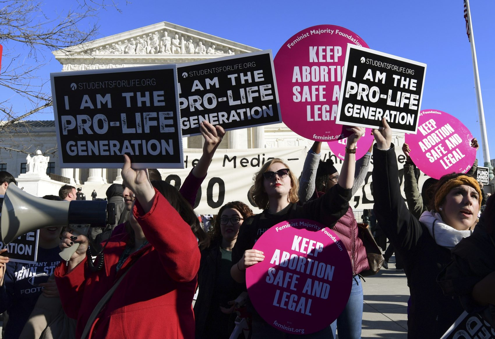 Protesters on both sides of the abortion issue gather outside the Supreme Court in Washington, Friday, Jan. 19, 2018, during the March for Life. (Susan Walsh/AP)