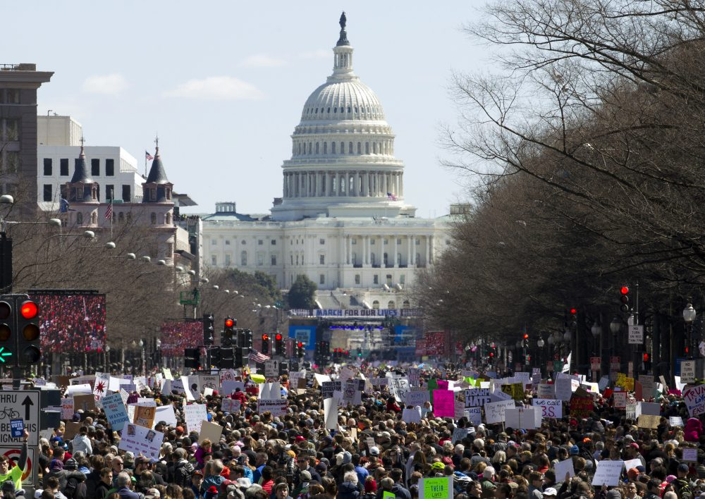 """Protesters stand on Pennsylvania Avenue looking east toward the stage located near the Capitol during the """"March for Our Lives"""" rally in Washington, Saturday, March 24, 2018. (Jose Luis Magana/AP)"""