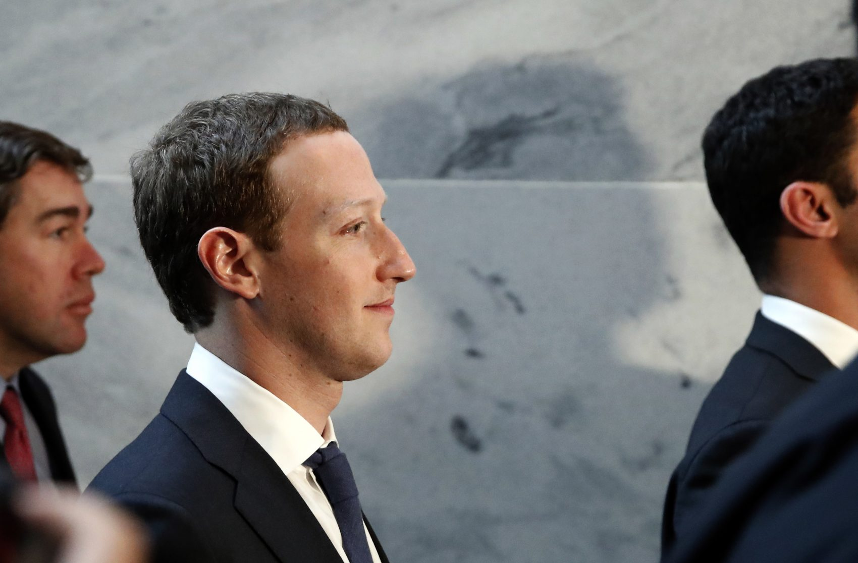 Facebook CEO Mark Zuckerberg departs after meetings with senators on Capitol Hill, Monday, April 9, 2018, in Washington. Zuckerberg will testify Tuesday before a joint hearing of the Commerce and Judiciary Committees about the use of Facebook data to target American voters in the 2016 election. (Alex Brandon/AP)