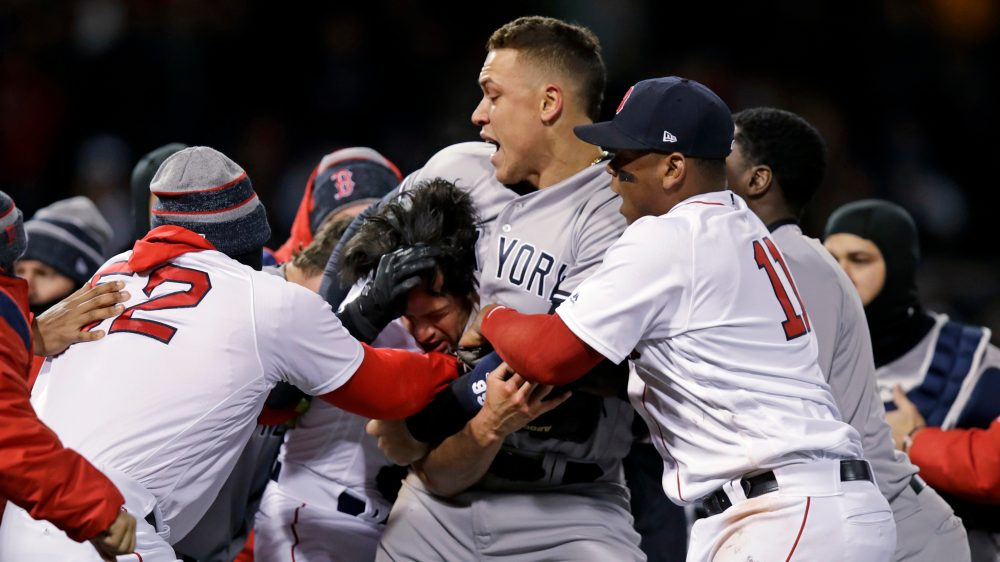 New York Yankees right fielder Aaron Judge puts Boston Red Sox relief pitcher Joe Kelly in a headlock after Kelly hit Yankees' Tyler Austin with a pitch during the seventh inning of a baseball game at Fenway Park in Boston, Wednesday, April 11, 2018. (Charles Krupa/AP)