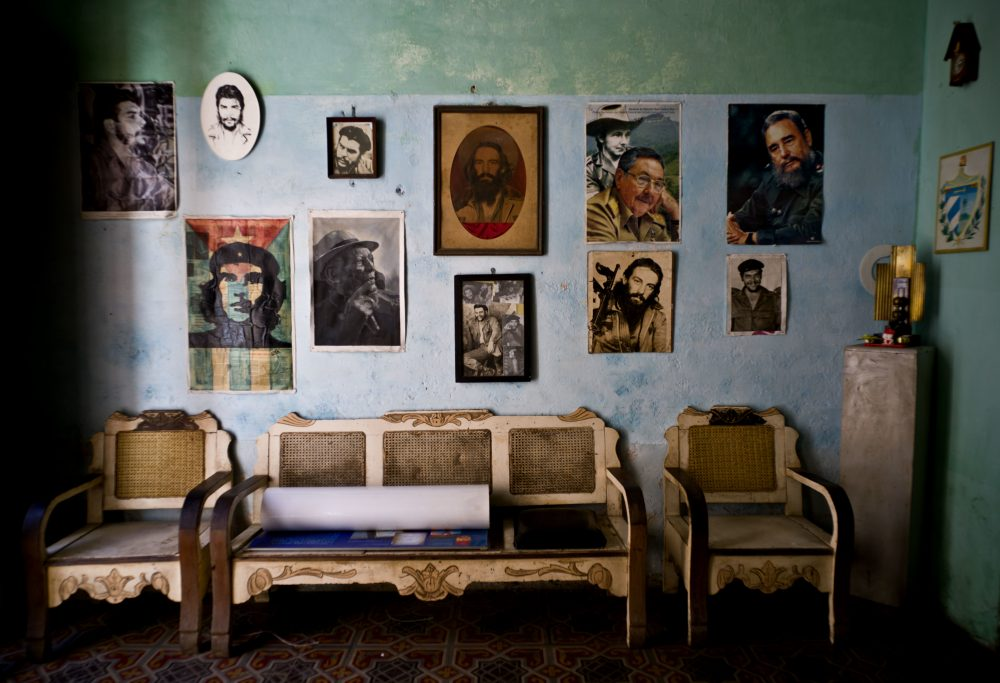 "In this March 15, 2016 file photo, images of revolutionary hero Ernesto ""Che"" Guevara, Camilo Cienfuegos , Fidel Castro, Raul Castro, and singer Compay Segundo, adorn a wall, in Havana, Cuba. (Ramon Espinosa/AP)"