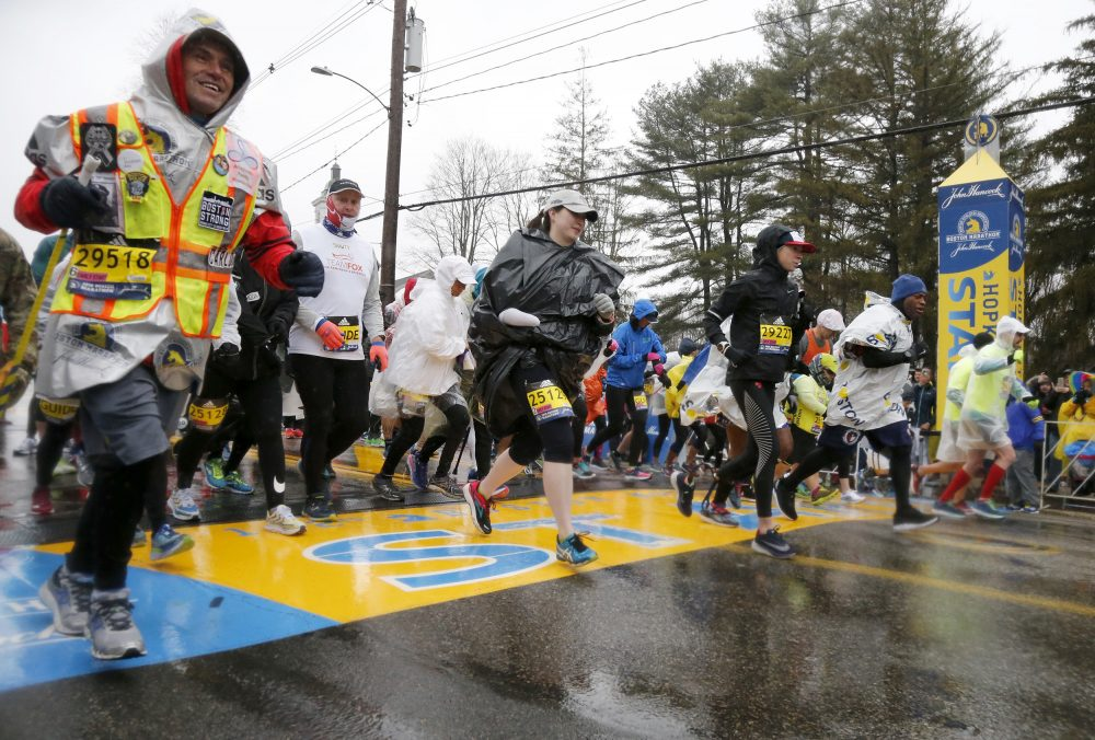Boston Marathon bombing hero Carlos Arredondo, left, joins others as they break from the start in the mobility impaired runner division of the 122nd running of the marathon on Monday. (Mary Schwalm/AP)