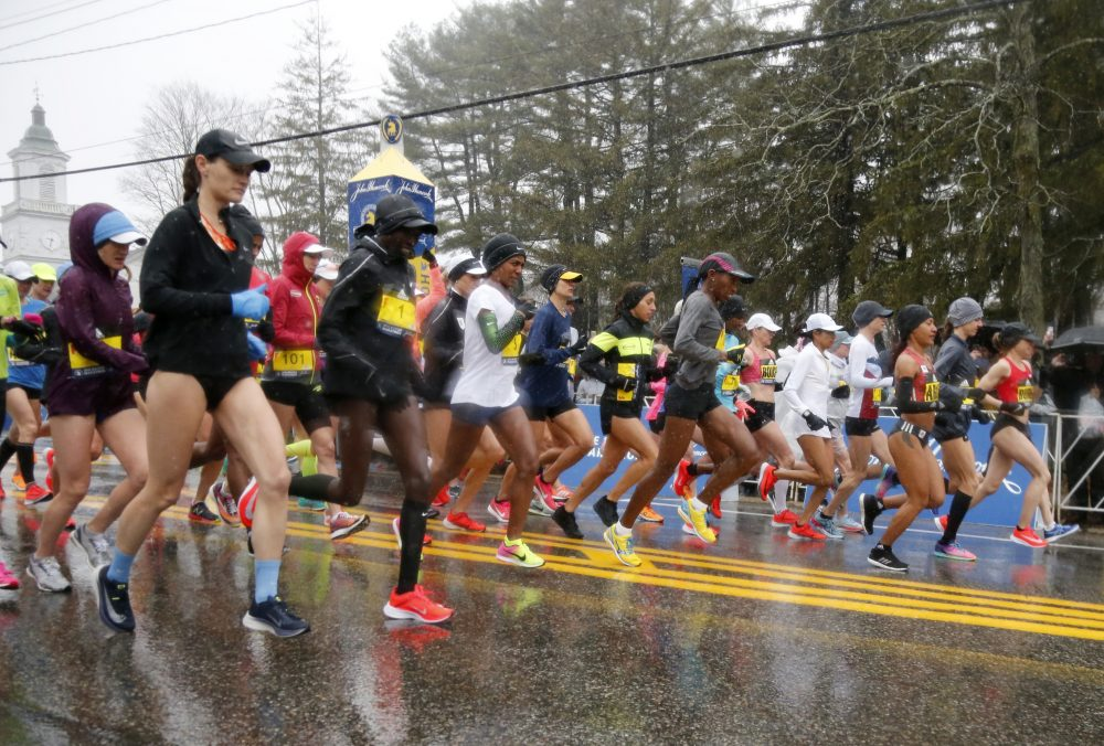 The elite female runners break from the starting line in a downpour during the 122nd running of the Boston Marathon. (Mary Schwalm/AP)