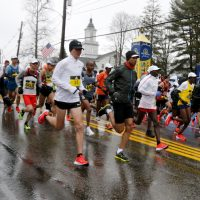 The elite men runners break from the starting line. (Mary Schwalm/AP)