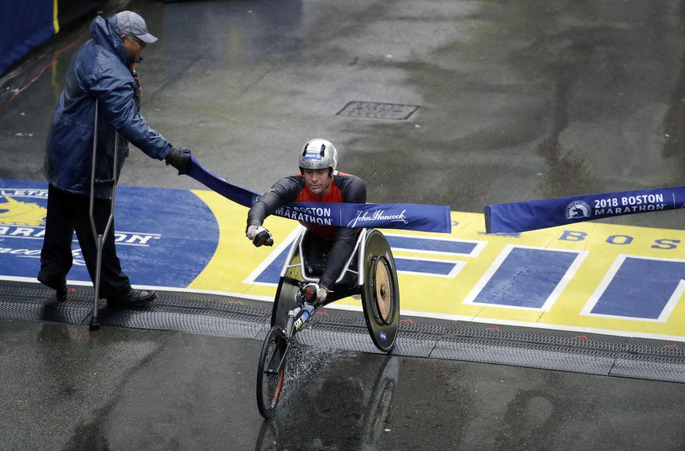 Marcel Hug, of Switzerland, crosses the finish line to win the men's wheelchair division. (Charles Krupa/AP)