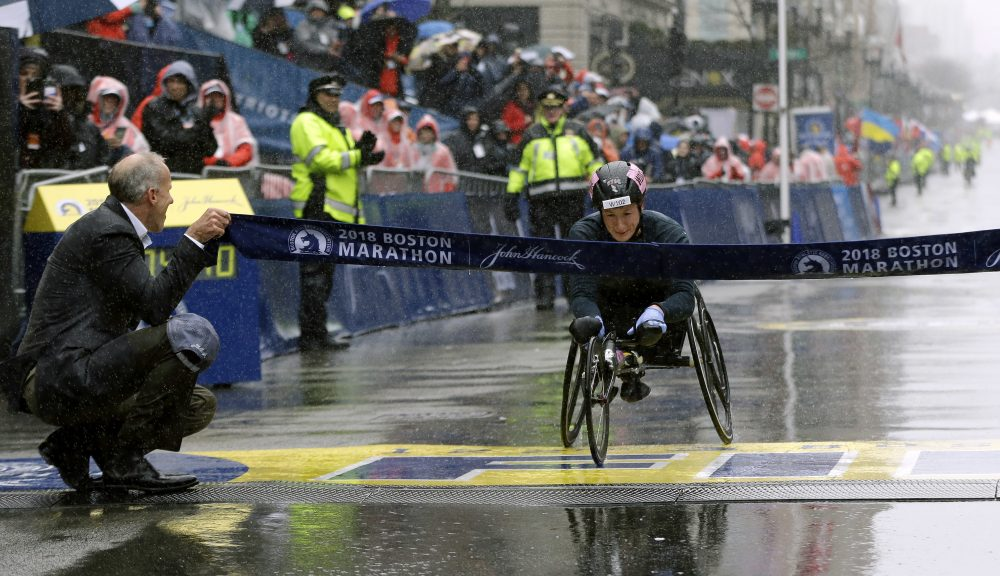 Tatyana McFadden, of the United States, crosses the finish line to win the women's wheelchair division. (Elise Amendola/AP)
