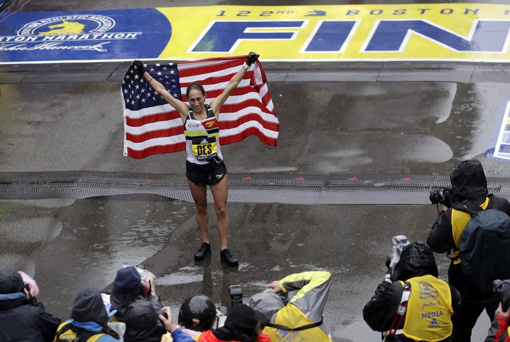Desiree Linden, of Michigan, celebrates after winning the women's division of the 122nd Boston Marathon. She is the first American woman to win the race since 1985. (Charles Krupa/AP)