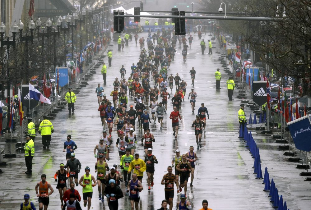Runners approach the finish line. (Charles Krupa/AP)