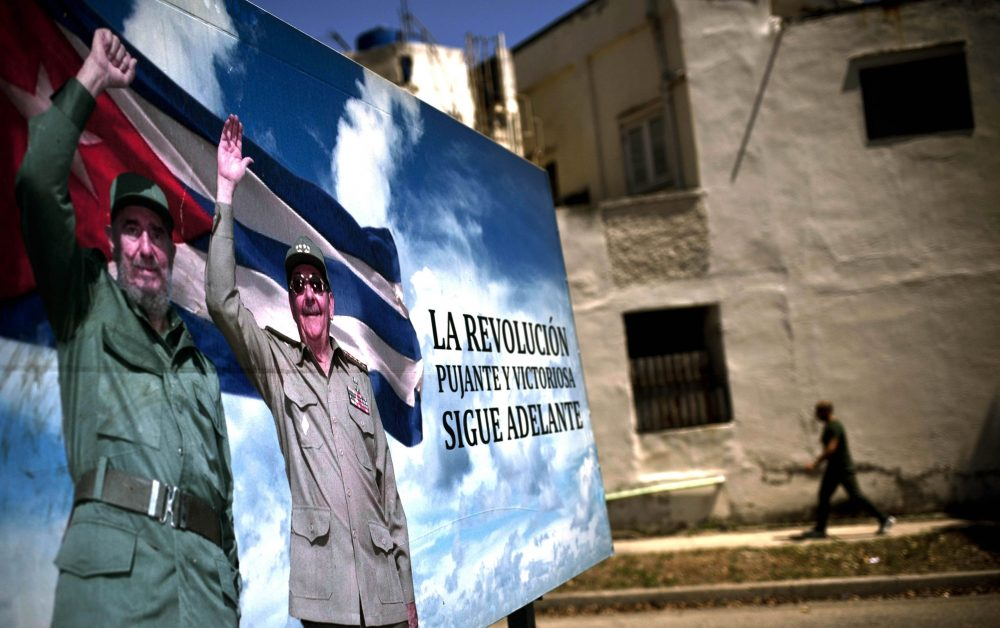 A poster of Fidel and Raul Castro stands in Havana, Cuba, Wednesday, April 18, 2018. (Ramon Espinosa/AP)